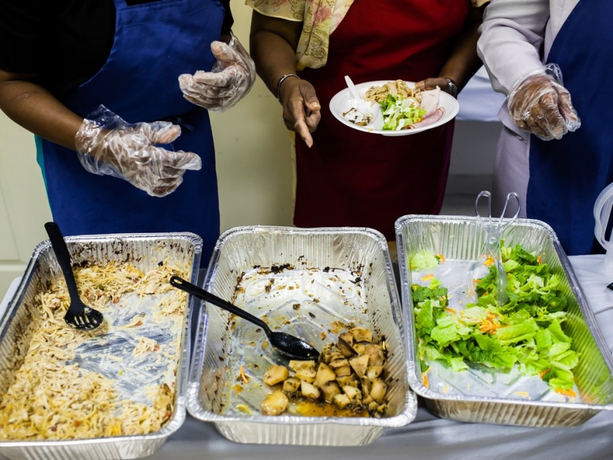 Church members serve healthy food to the congregation after the morning sermon.