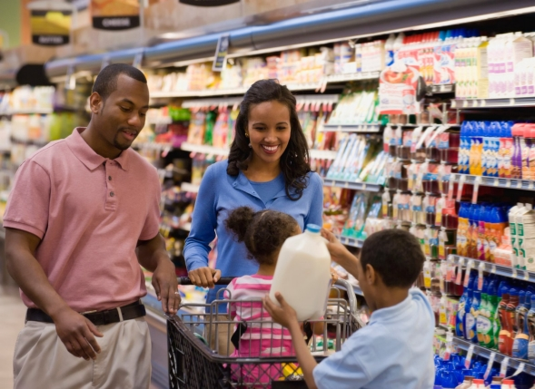 Family shopping together in grocery store.