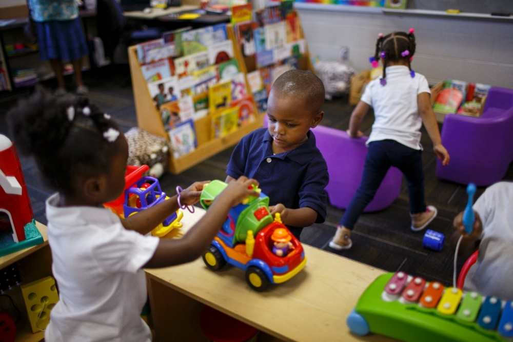 Children play at a Success By 6 and Parents As Teachers resource center at Faxon Elementary School in Kansas City, MO.