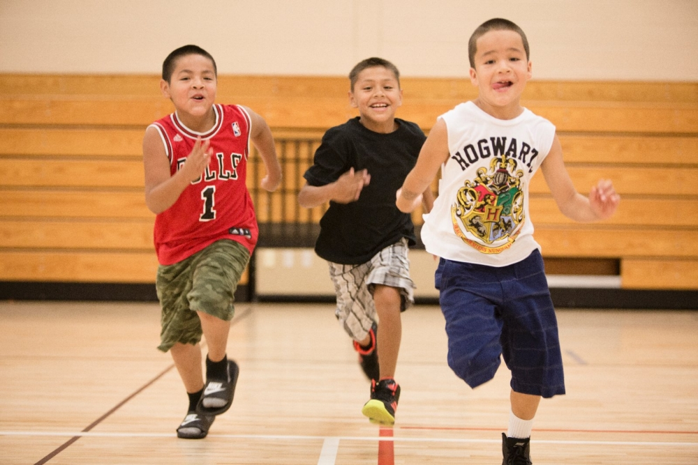Boys race each other during their physical education class.