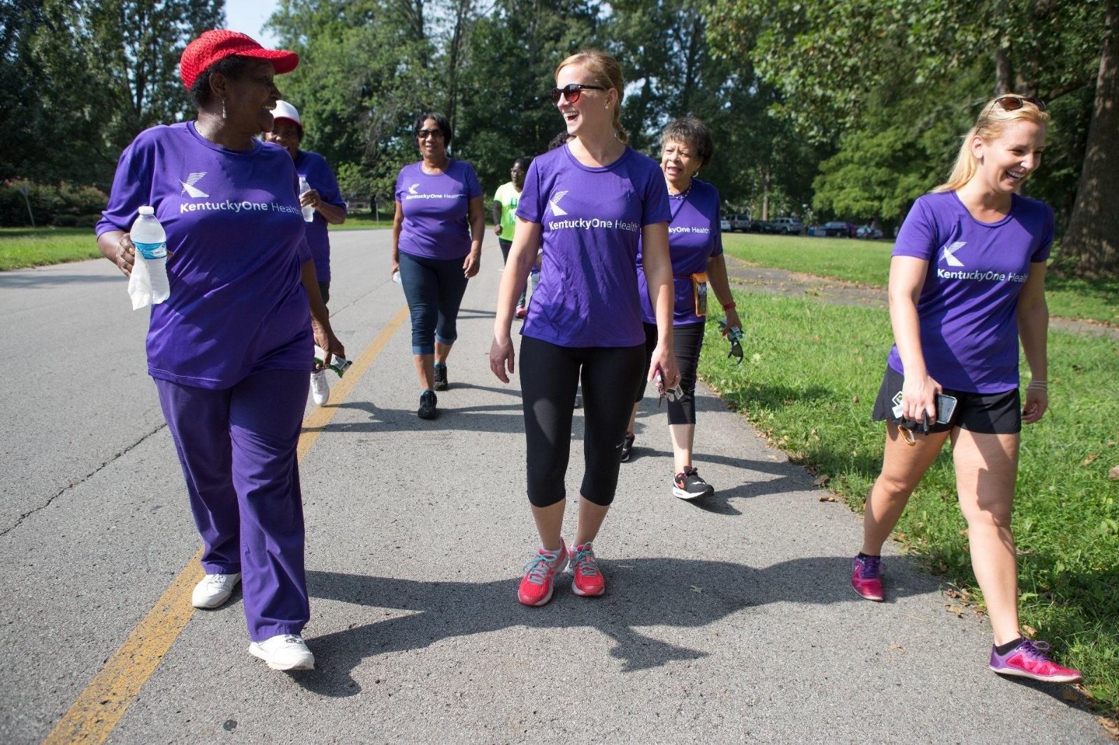 Participants talking during a charity walk.