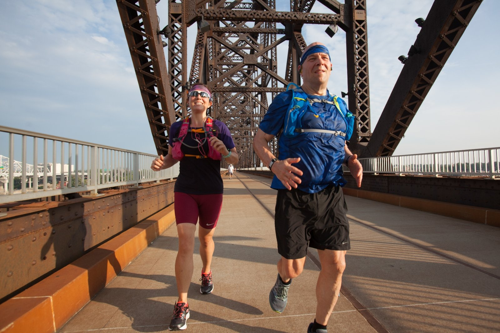 Runners training for a half marathon started across a bridge.
