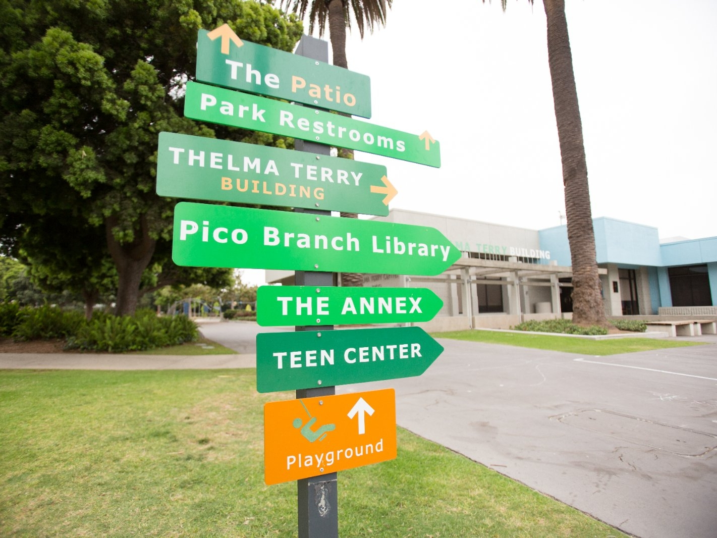 Road signs pointing to recreation areas.