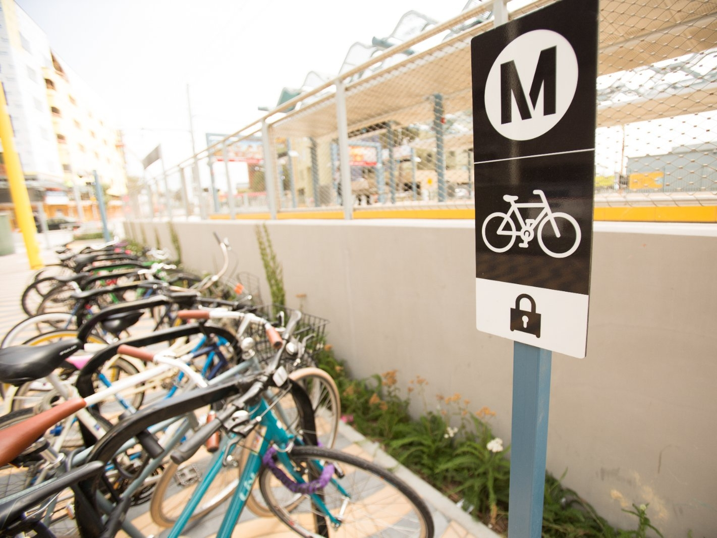A sign for bicycle parking at a rail station.