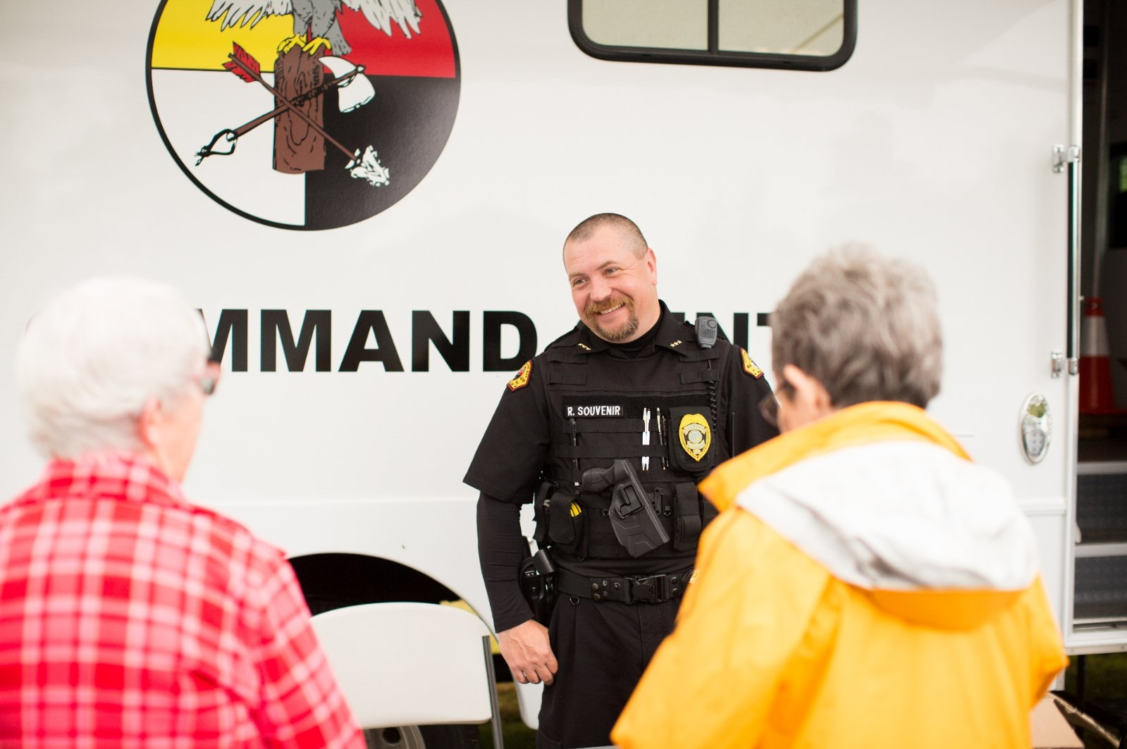 An officer educates the community.