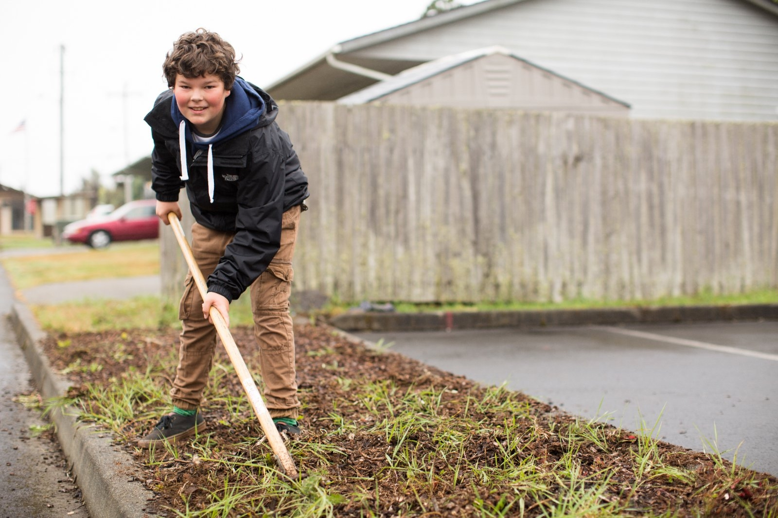 Young boy participates in a community landscaping project.
