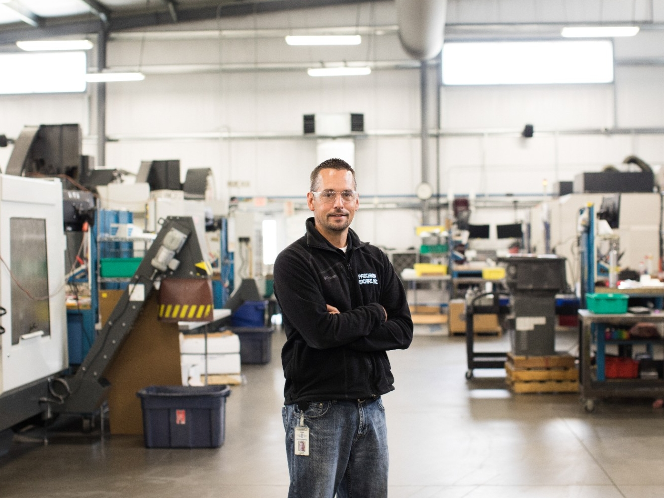A small business owner stands in the company's work shop.