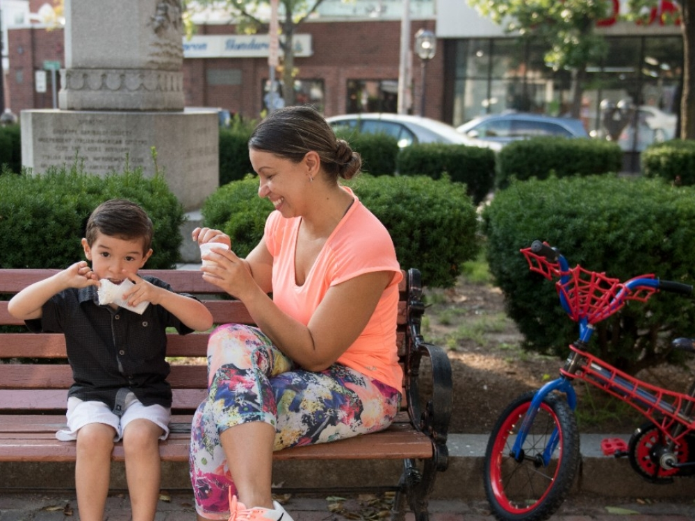 A mother and her son eat ice cream.