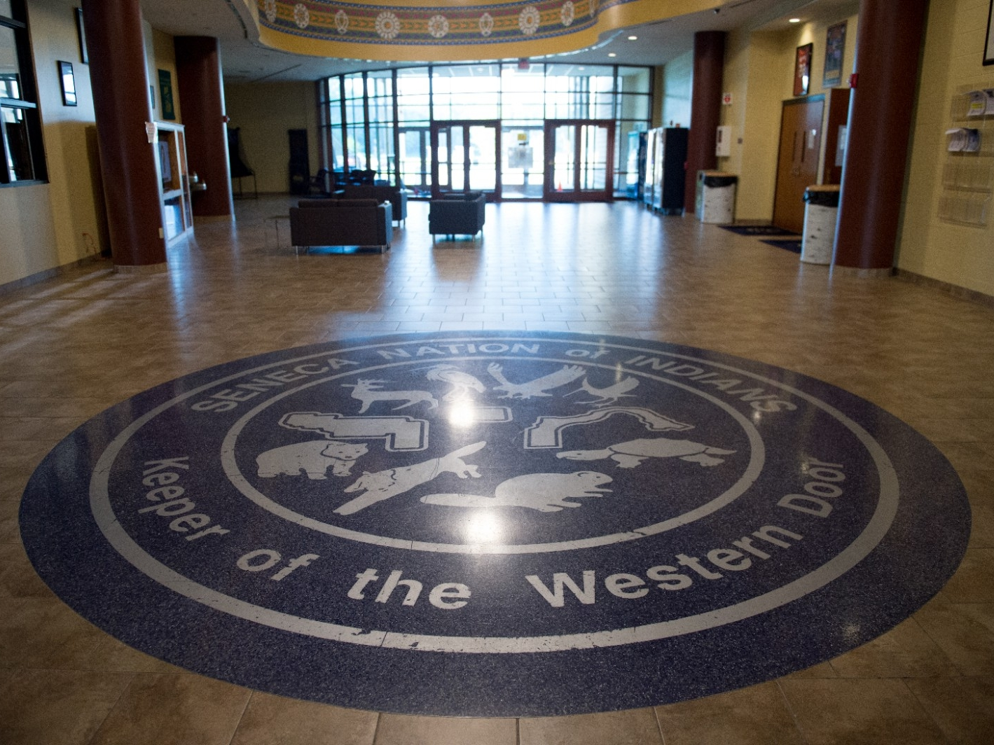 A floor decoration depicts the eight clans of the Seneca Nation at the Cattaraugus Community Center.