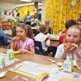 Students eating breakfast in their classroom.