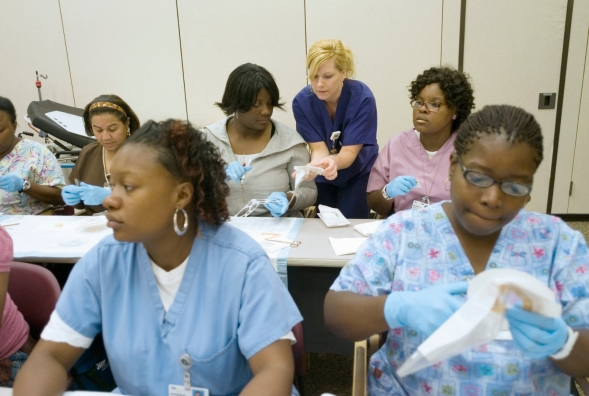 Student nurses receive instruction in a class.
