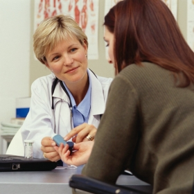 A physician consults with a patient about medicine.