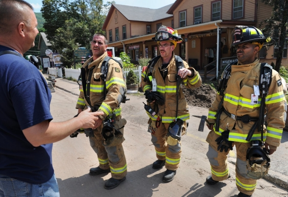 Firemen line up as part of RWJF Flood Relief - RWJF Flood Relief.