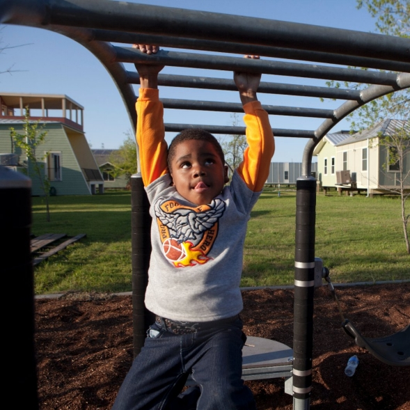 Boy plays at public park.