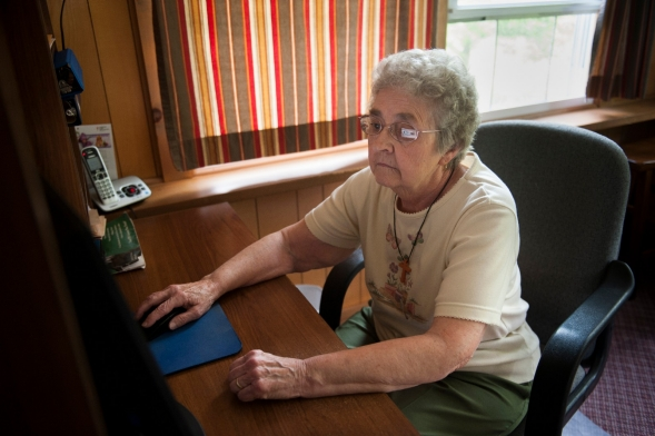 Older woman using a computer.