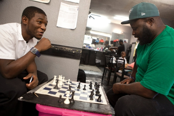 Two men of color playing chess
