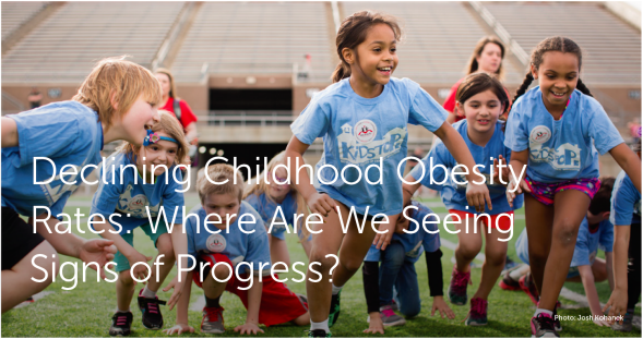 "Photo of children in a stadium with the language that says ""Declining Childhood Obesity Rates: Where Are We Seeing Signs of Progress?"""