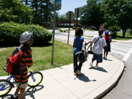 Children using the sidewalk to get to school.