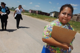 Health outreach women walk down road in rural area.