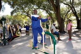 An elderly gentleman works out on the new Fitness Zone equipment at Oak Grove Park north of Miami, FL.
