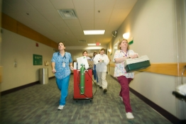 A critical response medical team walking in a hospital corridor.