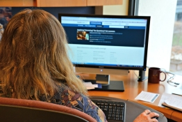 A women looks at the 2015 Affordable Care Act ACA Enrollment Website.