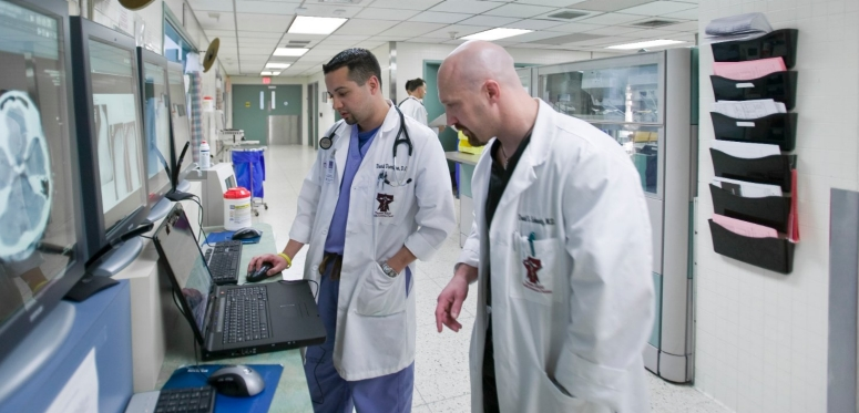 "Doctors playing ""Pulse,"" a virtual reality game for medical education."