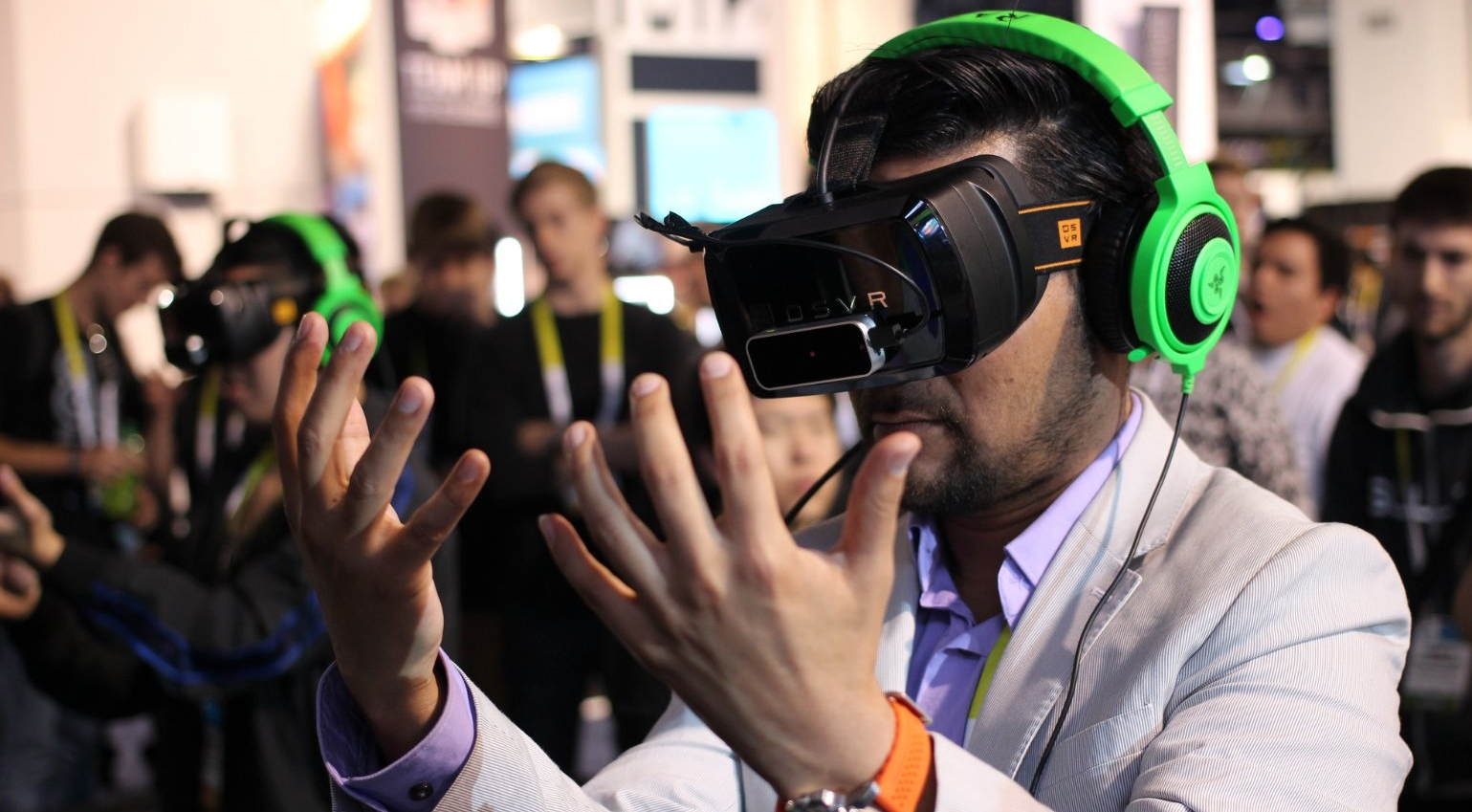 A man tests out a virtual reality headset.