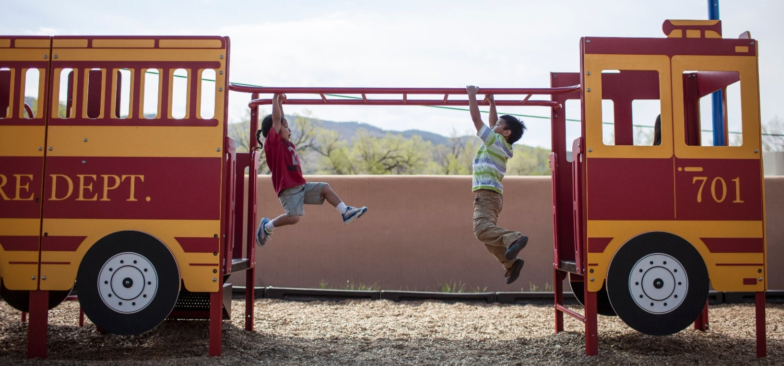 Children play in park in Taos, New Mexico.