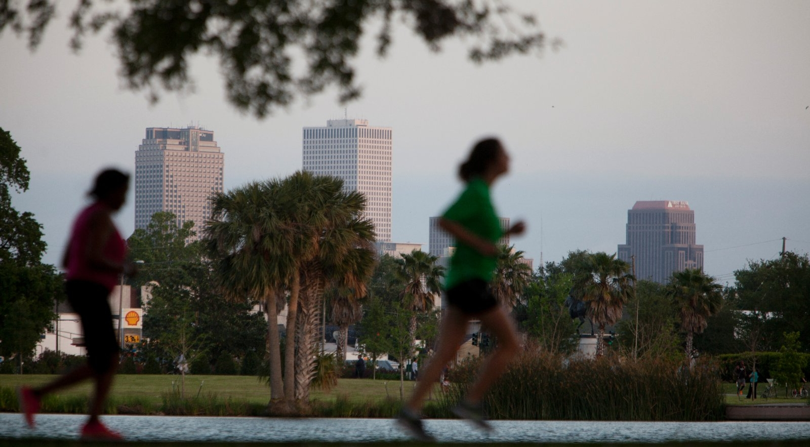 Runners along a New Orleans city park