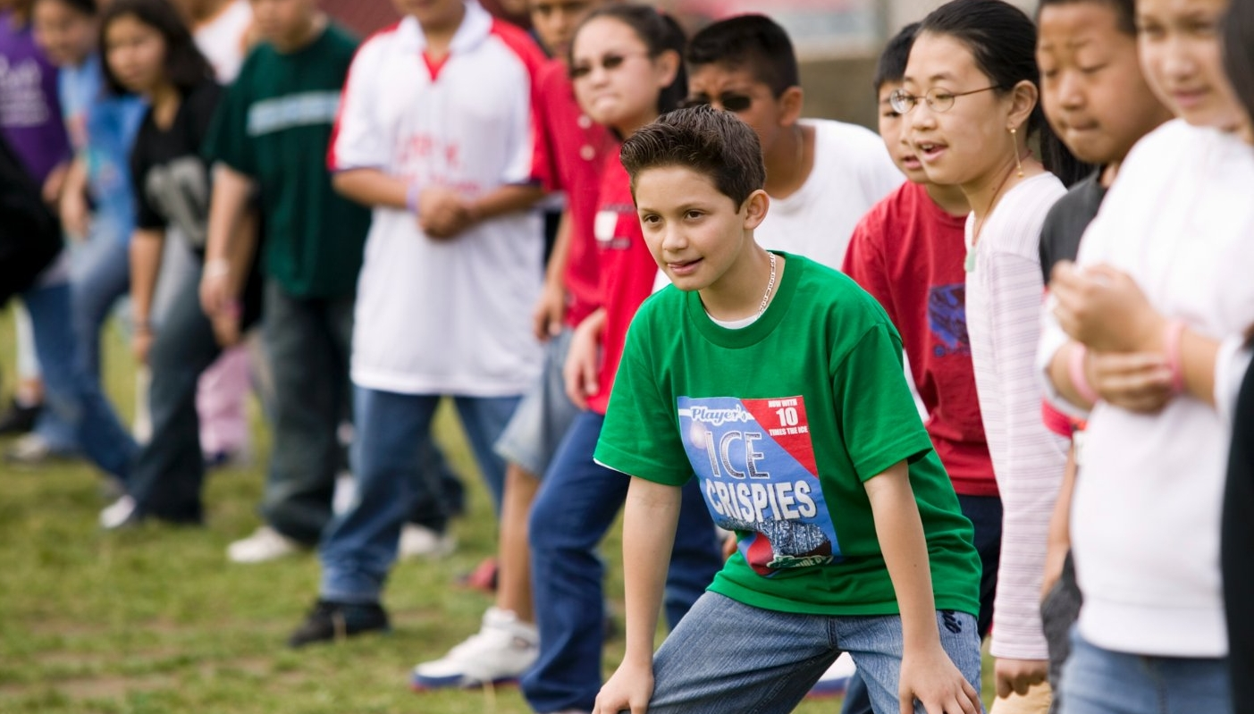 Students get ready to run in a game at school during recess.