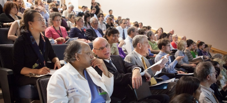 Attendees sit in the audience at The Science of Placebo conference.