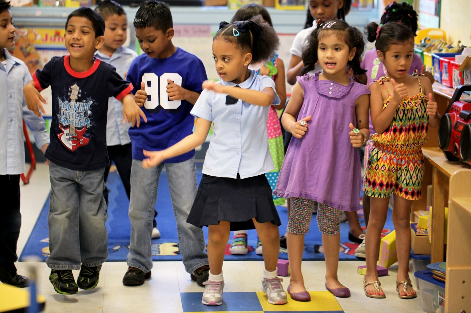Children dance to a song during school.