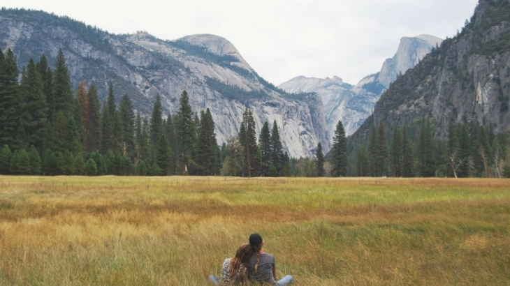 A couple looking at the mountains.
