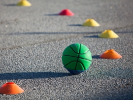 A ball is left on a playground after recess.