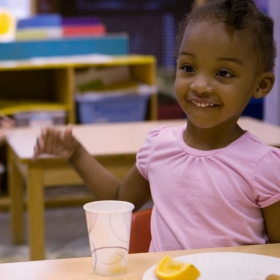 Children eat a healthy snack at school.