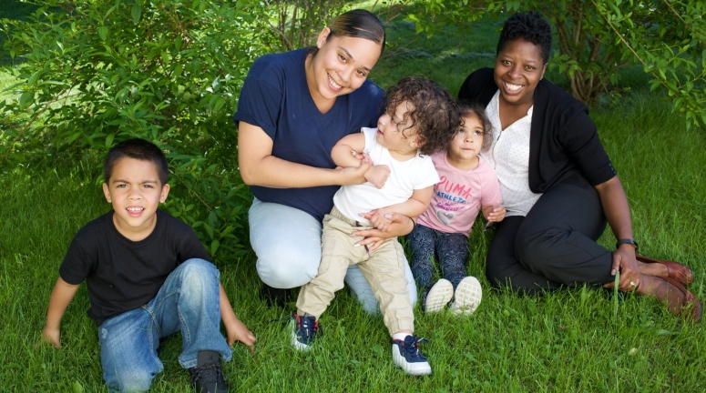 Supportive Housing program case worker, Melissa Rowe (right) with her client Irma and three of Irma's four children.