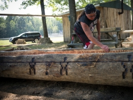 John Redeye finishes a dugout canoe which he made in the traditional style from white pine.
