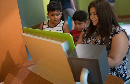 A family checks out an interactive exhibit.