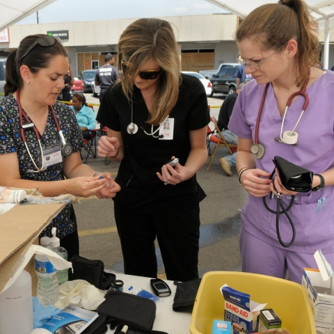 Relief workers sort through donated medical supplies.