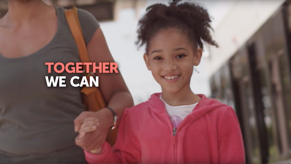 "Girl holding an adult's hand with message, ""together we can."""