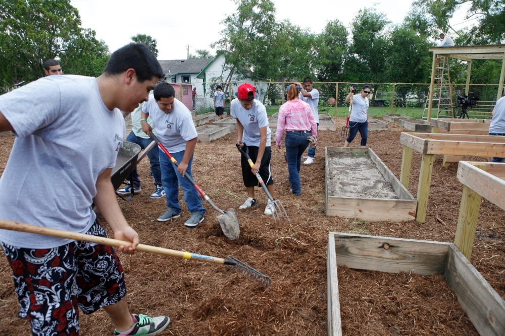 YouthBuild students work at the Belden Community Garden in Brownsville, Texas.