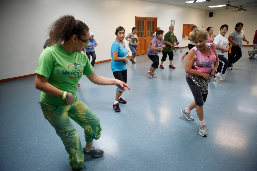 Alba de Opengo leads a zumba class at Good Shepherd Catholic Church in Brownsville, Texas.