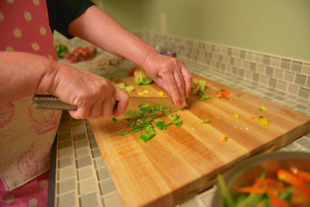 A woman prepares food at the Williamson Health and Wellness Center in Williamson.
