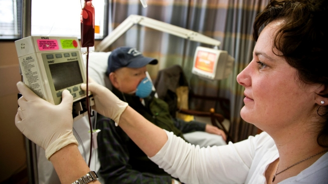 A nurse administers chemo therapy in the John Theurer Cancer Center.