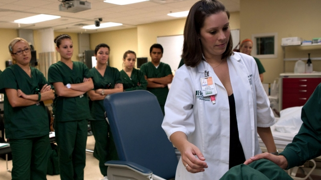 Nursing students learning skills during a class.