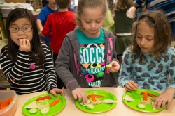 Children in DuPage, Illinois enjoy a healthy snack.