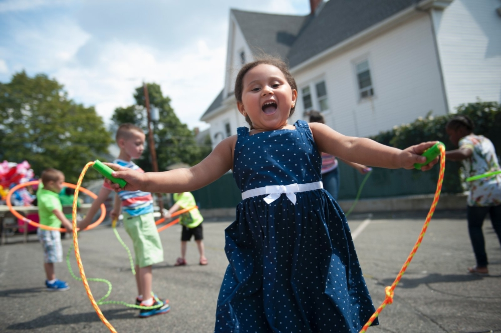 A girl jumps rope during a block party.