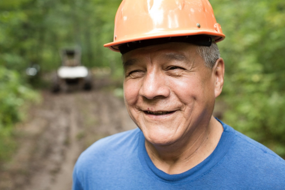 A man at a sustainable wood harvesting mill in Neopit, Wisconsin.