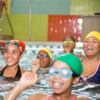 Community members participate in a swim class.